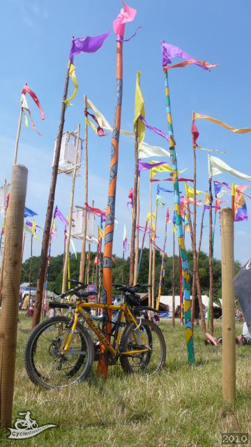 CycleStreets » Bike amongst the flags at the Glastonbury Festival
