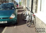 Bicycle badly parked on a narrow street